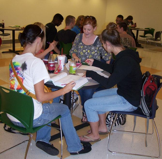 Laura Lang, a nursing student, studies with other students in the Douglasville Student Center.