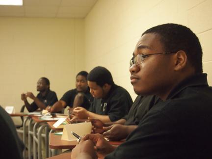 From left: Travis Boyce, Jordan Walters, Chris Carter and Shanton'eo Elkins listen to Bledsoe's presentation. Photo by Scott Hale.