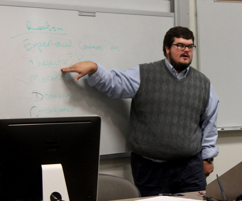 Jesse Bishop speaks to one of his classes on the Cartersville campus. Photo by Katie Morris.