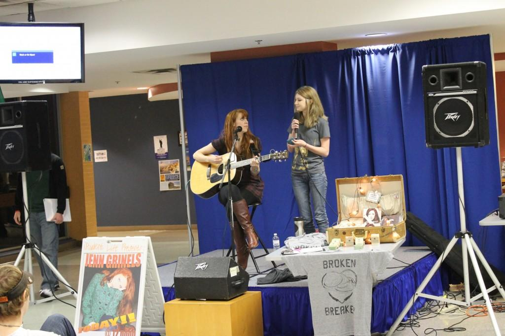 Jenn Grinels (left) and student Korie Hetter prepare to perform a duet during a performance on the Floyd campus. Photo by Ryan Jones.
