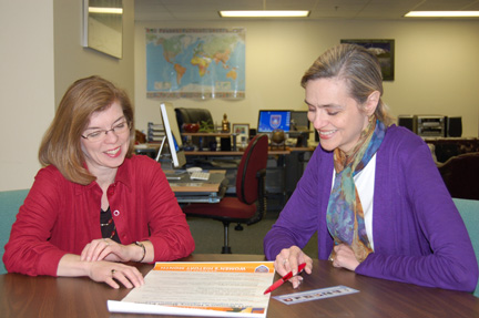 Laura Musselwhite (left) and Carla Patterson plan events for the upcoming Women's History Month on the Floyd campus. Photo by Denise Perez Campos.