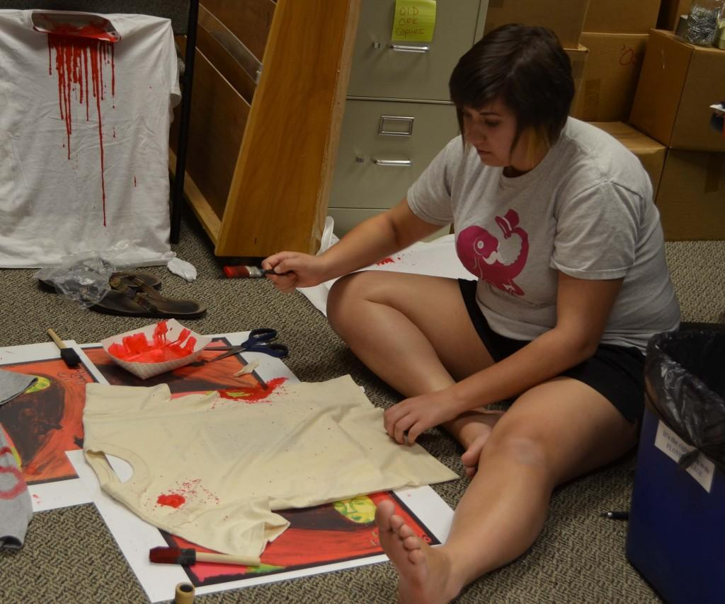 Becca Layson works on t-shirts to promote the ORK. Photo by Kaitlyn Hyde