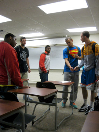 From left: Darice Parks, Matt Welch, D.J. Milner, Cody Washington and Trent Burton come together at a Brother 2 Brother meeting at Floyd. Photo by Pedro R. Zavala.