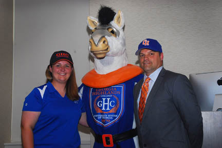 Softball coach Melissa Wood, left, and baseball coach Mike Marra are welcomed to GHC by Bolt, the mascot. Photo by Sarah Warren.