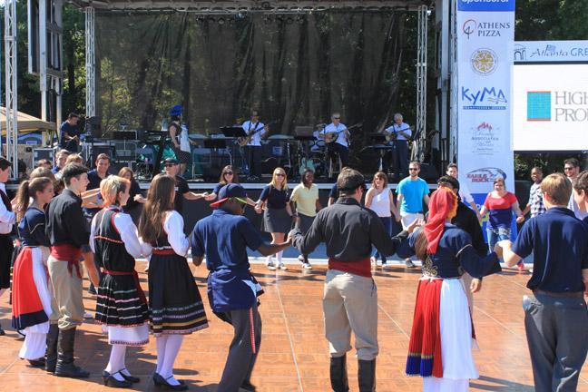 Atlanta Greek Festival attendees dance together. Photo by Jessie Summers.