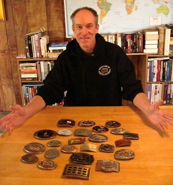 Scott Brockmeier presents buckles for every time he ran a race in 2012. Photo by Virginia Robinson.