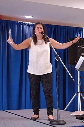 Caroline Rothstein perfoming spoken word poetry at the Floyd campus. Photo by Ryan Jones.