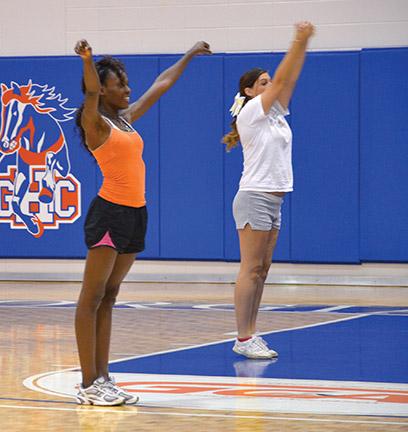 Cheerleaders Ngozi Eme-Akwari and Taylor Whitaker practicing cheer routines. Photo by Pedro Zavala.