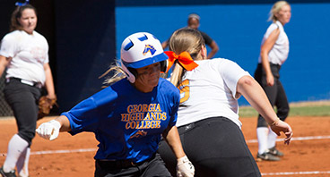 Jessie Ricks, number 22, is called safe as she reaches third base. Photo taken by Richard Maneen.