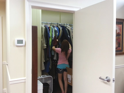 Rebecca Curtis looks at clothes in the Clothes Closet on the Floyd Campus. Photo by Virginia Robinson.