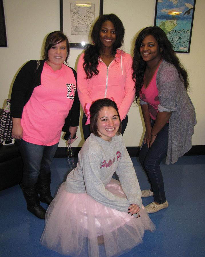 Students participating in Woman 2 Woman breast cancer awareness event on the Douglasville campus. In back, from left are Chelsea Hadaway, Ednard Salvant and Edlinard Salvant. Kneeling is Brooke Smith. Photo by Holly Chaney.