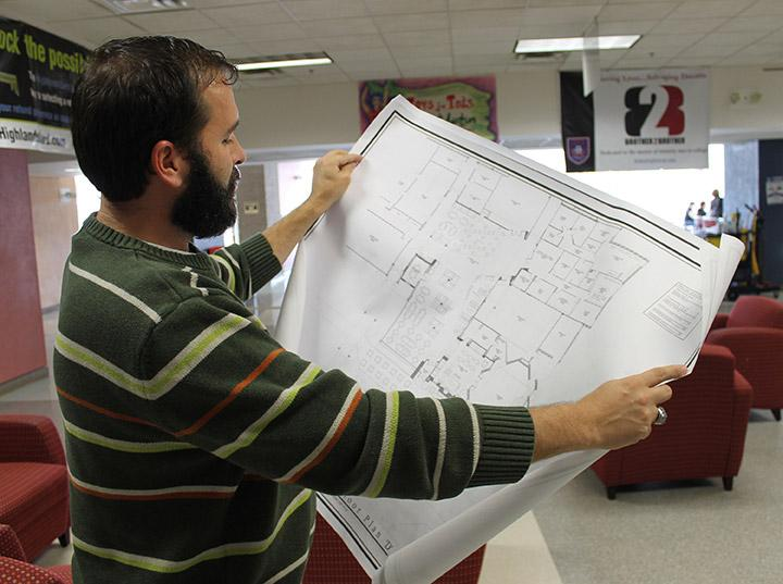 John Spranza looks at the blue prints for the student center remodel by Ryan Jones
