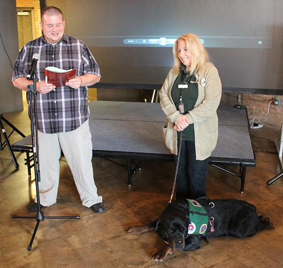 Kenneth Shuman, Georgia Northwestern Technical College student, reads his story from the Facing Project while Catherine Varidel listens with her service dog Gryphon by Ryan Jones