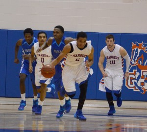 Montrel Goldston rushes past Gordon's defense during the first home game of the 2013-2014 season. Goldston was a top scorer with 14 points. Photo by Pedro Zavala