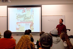 Joe Samuel Starnes shows his Sears catalog from the 1950's that he used for research in his novel.