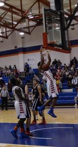 Donovan Harris dunks during game against LaGrange. Photo by Karlee Helms.
