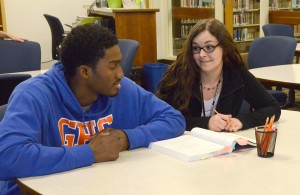 Donavan Harris (left) is tutored by Jennifer Hicks (right) in the Tutorial Center. Photo by Pedro Zavala