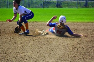 Freshman, Kayleigh Medlin slides into first base. Photo contributed