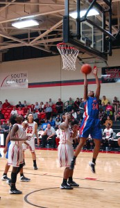 Aujuana Dawkins makes a jump shot in the Lady Chargers' GCAA championship game against the Lady Jets.