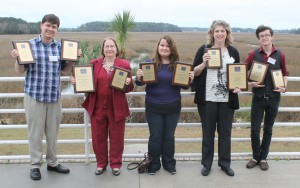Six Mile Post staff members and advisers hold some of the awards received for journalism excellence during the Southern Regional Press Institute hosted by Savannah State University. From left to right, Ryan Jones, chief photographer; Kristie Kemper, adviser; Ashlee Gilley, staff writer; Cindy Wheeler, assistant adviser; and Antonio Garcia, managing editor of online. Photo contributed.