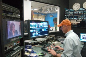 "Jeff Brown, director of digital media services, edits footage in the control room at GHTV during the taping of ""Community Watch."" Photo by Derweatra Hammock."