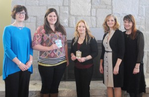 Amelia Bagwell (center) is the winner of the first Women's History Month Essay Contest at Georgia Highlands and runner-up Samantha Crider (inner-left) stand with Leslie Johnston, instructor of English (outer-left), Leslie Johnson, assistant professor of communication (inner-right) and Stacy Brown, assistant librarian (outer-right).