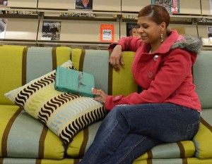 Danielle Roberson on a date with her mystery book. Photo by Derweatra Hammock.