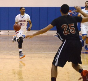 Demaurius Morgan, number 20, moves the ball down court in the last home game of the 2013-14 season. Photo by Karlee Helms.