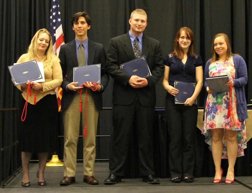 (From left) Amelia Bagwell, Julian Orjuela, Stephen Hood, Laurel Wickman and Marilyn Trudeau-Walls recieve their URIT certificates. Photo by Ryan Jones.