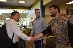 From left: New Georgia Highlands President, Donald J. Green, greets students Hunter Walden and Adam Hatcher in the Floyd campus library. Photo by Jeremy Huskins.