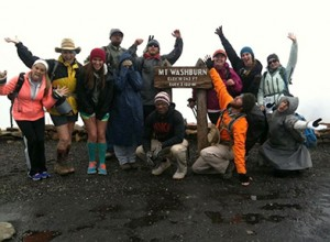 Students from left Erika White, Illiana Alderfer, Cassidy Alderfer, Clint Richards, Amanda Nieman, Wes Chambers, Justin Shooks (kneeling), Alisha Rowell, Matt Williams, Breanna Gehweiler, Amanda Haulk, Mayra Chavez hiked up Mt. Washburn during the storm. This is also where Matt Williams surprise proposal took place. Photo by Kiston Dowler.