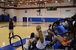 Ken Irvin talks to the basketball teams about the importance of education. Photo by Karlee Helms.