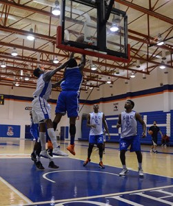 From left: Denzel Council attempts to block Donovan Harris as Terrence Thompson and Ty Toney await the rebound during a recent basketball workout. Karlee Helms.