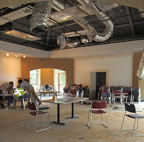 Construction workers confer during the Floyd campus Student Center renovation.  Photo by Callie Stokes.