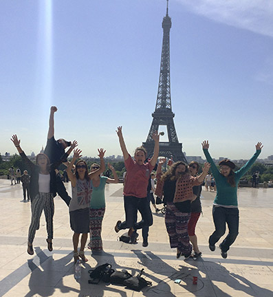 Trip participants show their enthusiasm in front of the Eiffel Tower. They are Matt Massey (left rear) and (from left) Halie Hicks, Alex MacMurdo, Karley Callaway, Annie Hill, Hillery Sawyer, Topher Knight and Megan Broome. Photo by Amanda Howell.