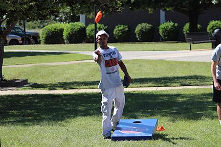 André Evans participates in the cornhole promotion. Photo by Adam Hatcher.