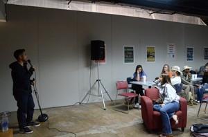 Erik Rivera jokes to the crowd by Anna Douglass