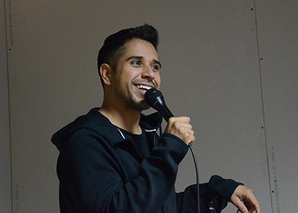 Erik Rivera laughs during performance.  Photo by Anna Douglass
