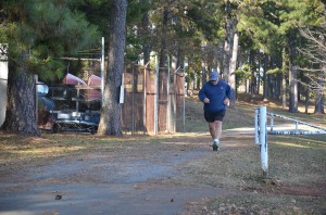 Bill Cox, male winner of the 2014 Floyd campus Turkey Walk-Run, approaching the finish line.