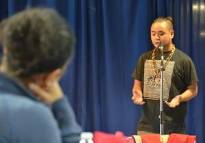 Students gather in the Floyd campus Student Center to hear G. Yamazawa's slam poetry. Photo by Jeremy Huskins.