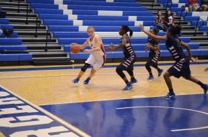 Deana Blankinship skillfully works her way around members of the opposing team.