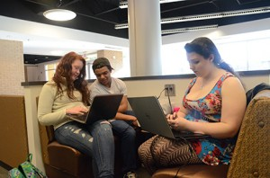 (From left) Student Lauren Glass, friend Zach Daum, and student Jennifer Burks study in the Student Center. Photo by Anna Douglass.