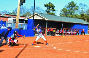 Kristen Mullis hits  a ball during the first softball game of the season against Gadsden State Community College. Photo by Shelby Hogland