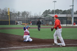 Blake Oxenreider slides safely into third base, March 1. Photo by Shelby Hogland.
