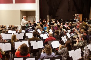 Professor of music directs local orchestra. Photo by Jeremy Huskins