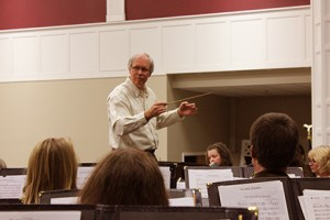 Samuel Baltzer conducts the NW GA Winds during one of their recent concert rehearsals. Jeremy Huskins.