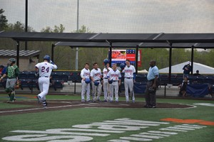 Chargers welcome Zach McCrum at home plate after his grand slam on April 7. Photo by Shelby Hogland.
