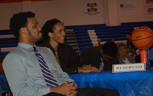Chargers basketball team members listen to a praise for their season. Photo by Anna Douglass