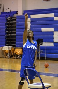 Alesheia Johnson practices her shooting during basketball workouts.