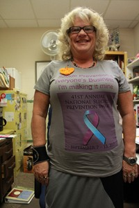 Susan Claxton, human services program coordinator, shows off her suicide awareness T-shirt. Photo by Lydia Chandler.